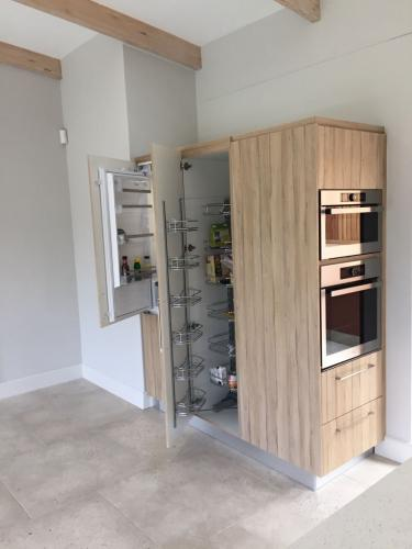 Built in cupboard with built in pantry and appliances